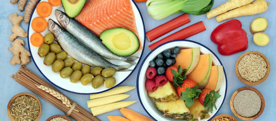 Health food to ease irritable bowel syndrome. Healthy foods high in antioxidants, protein, dietary fiber, vitamins, minerals, omega 3, protein, smart carbs & anthocyanins. Flat lay.